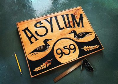 asylum wooden sign