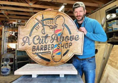a cut above the barber shop custom sign