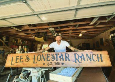 lee's lonestar ranch sign held by Matt