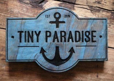 tiny paradise sign