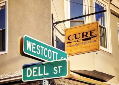 cure restaurant wooden signs